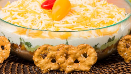 Photo of Mexican-Style Layered Dip by Snack Factory® Pretzel Crisps®
