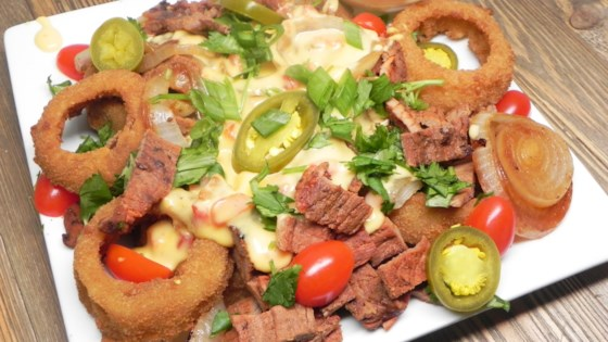 Photo of Cheesy Steak and Onion Ring Nachos by Julie Hubert