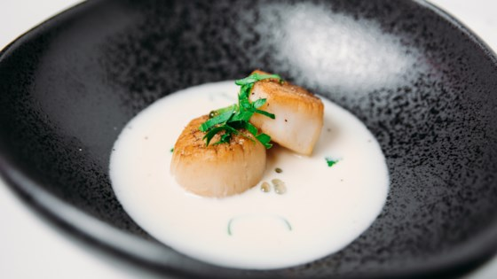 Photo of Scallops with Roasted Garlic Cream Sauce by Mitzi