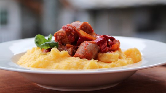 Photo of Sausage and Peppers over Creamy Parmesan Polenta by Julie Hubert