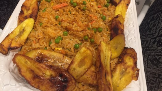 Photo of Nigerian Jollof Rice with Chicken and Fried Plantains by Daisy