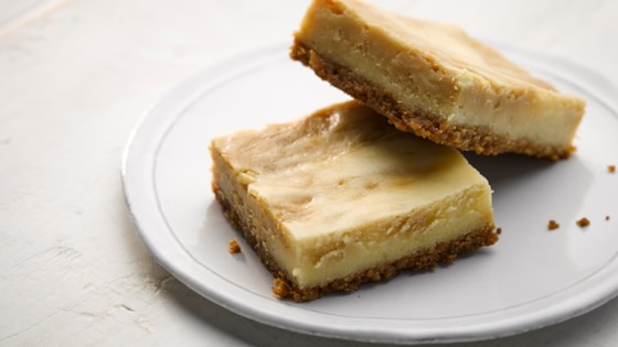 Photo of Sea Salt Caramel Swirl Cheesecake Bars by HERSHEY'S Kitchens
