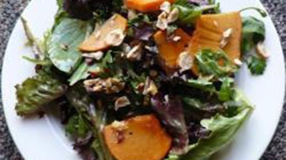 Photo of Mixed Greens with Hazelnuts and Persimmons by Nicola