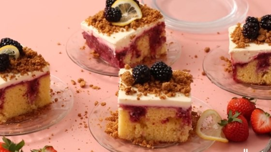 Photo of Triple Berry Cheesecake Poke Cake by Julie Hubert