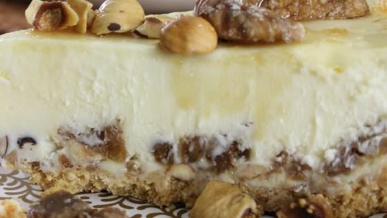 Photo of Fig-Hazelnut Cheesecake with Honey-Bourbon Drizzle by Sandra Garth