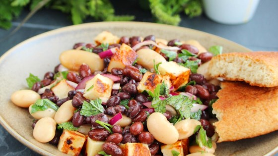 Photo of Halloumi Three-Bean Salad with Pomegranate-Harissa Vinaigrette by Buckwheat Queen