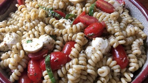 Photo of Pesto Pasta Caprese Salad by thedailygourmet