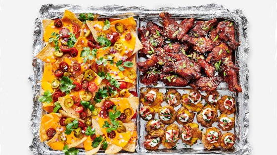 Photo of Sheet Pan Nachos, Sticky Sesame Ginger Wings, and Smashed Loaded Potatoes from Reynolds Wrap® by Reynolds Kitchens®
