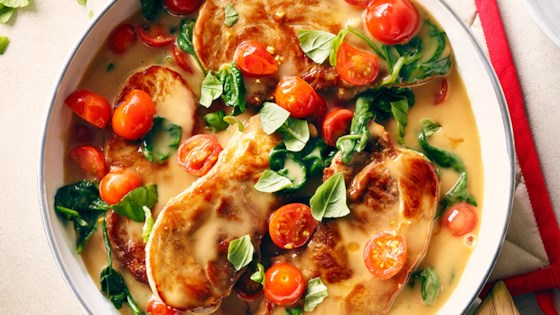 Photo of CAMPBELL'S® Saucy Pork Chops with Spinach and Tomatoes by Campbell's Canada