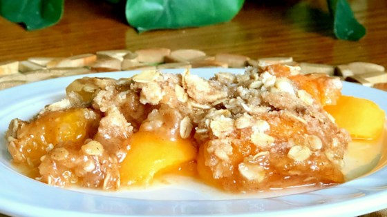 Photo of Slow Cooker Peach Crisp by Amy Woessner
