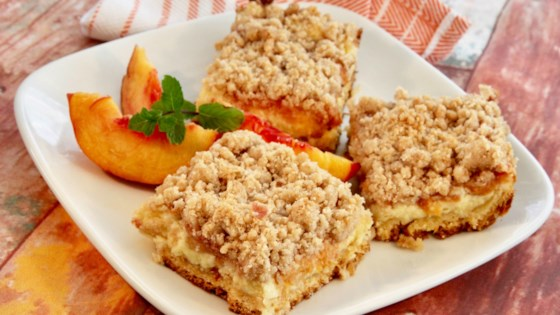 Photo of Peach Cobbler Cheesecake Bars by lutzflcat