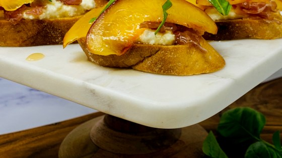 Photo of Grilled Peach and Ricotta Crostini by Jlopez