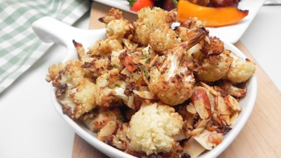 Photo of Air-Fried Cauliflower with Almonds and Parmesan by Allrecipes