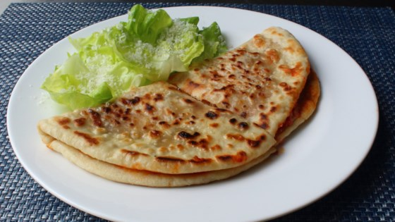 Photo of Pizzadilla (Grilled Pizza Sandwich) by Chef John