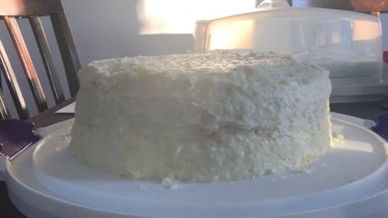 lemon cake with lemon filling and citrus coconut frosting