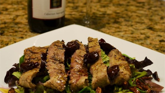 Grilled Peppercorn Steak and Caramelized Pecan Salad with Cabernet-Cherry Vinaigrette
