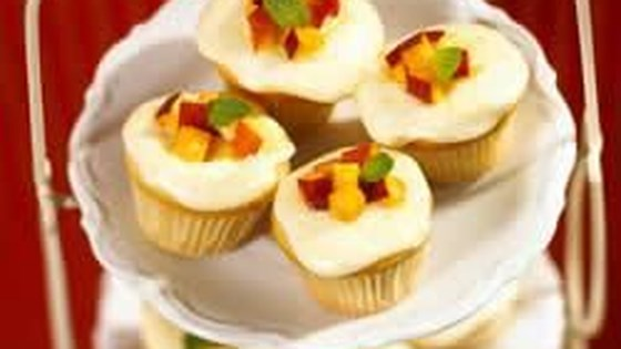Photo of Mini Vanilla-Almond Peach Cupcakes with Fresh Peach Frosting by EatCaliforniaFruit.com