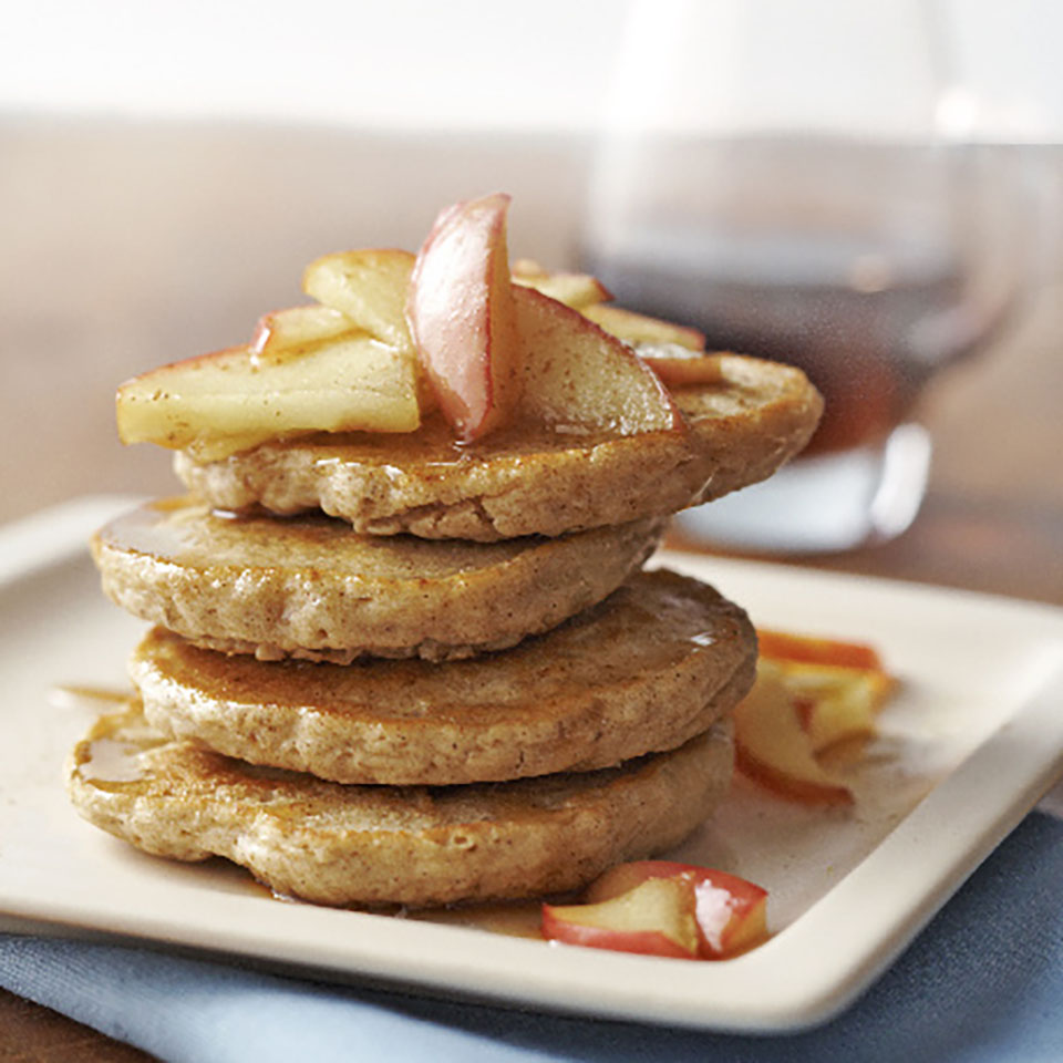 These mini whole-wheat and oatmeal pancakes are a satisfying way to start your day. They're flavored with yummy spices and topped with warm, sautéed apples and maple syrup. Close your eyes and you may just think you're eating apple pie for breakfast!