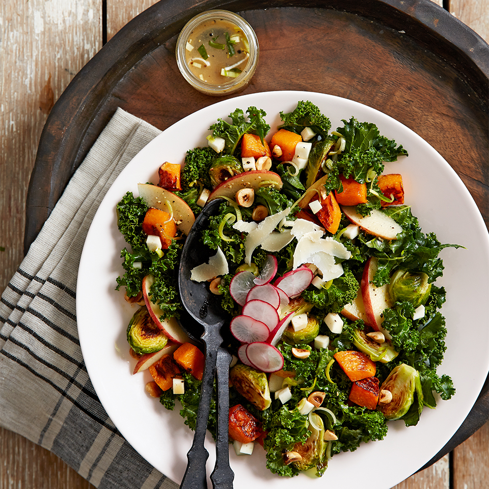 A wonderful kale salad with roasted butternut squash and Brussels sprouts features a special vinaigrette dressing and a topping of toasted hazelnuts and Parmesan cheese. You'll be proud to serve this gourmet treat at any formal meal.