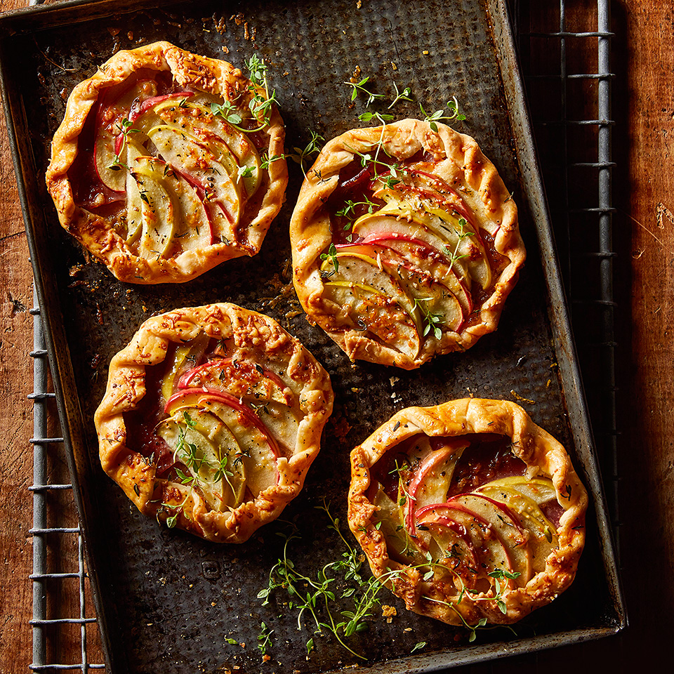 Prepared pie crusts make assembling these free-form tarts quick and fast. Feel free to swap in your favorite jam, meat or cheese. Serve with a simple green salad for an easy brunch or light dinner.