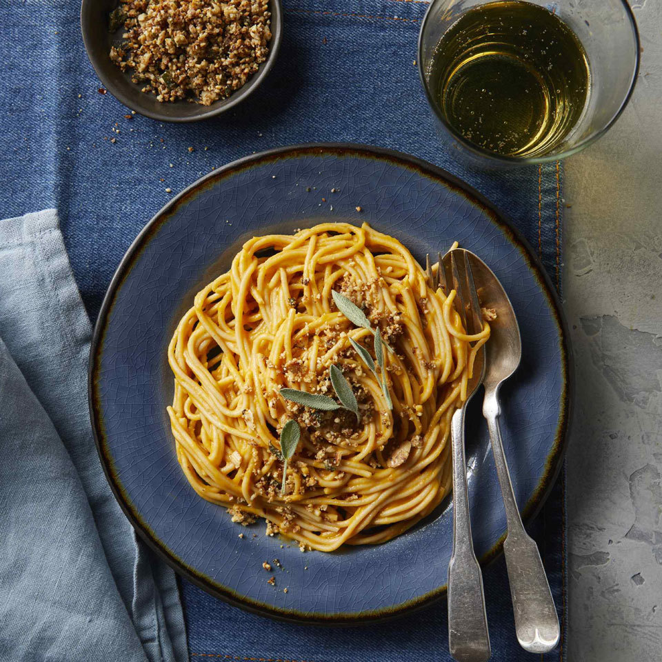 Carbonara, traditionally bathed in eggs, gets a vegan makeover using roasted and pureed butternut squash instead to make it ultra-creamy. A topping of ground almonds, garlic and sage gives it texture and an herby, savory flavor in place of the cheese and bacon.