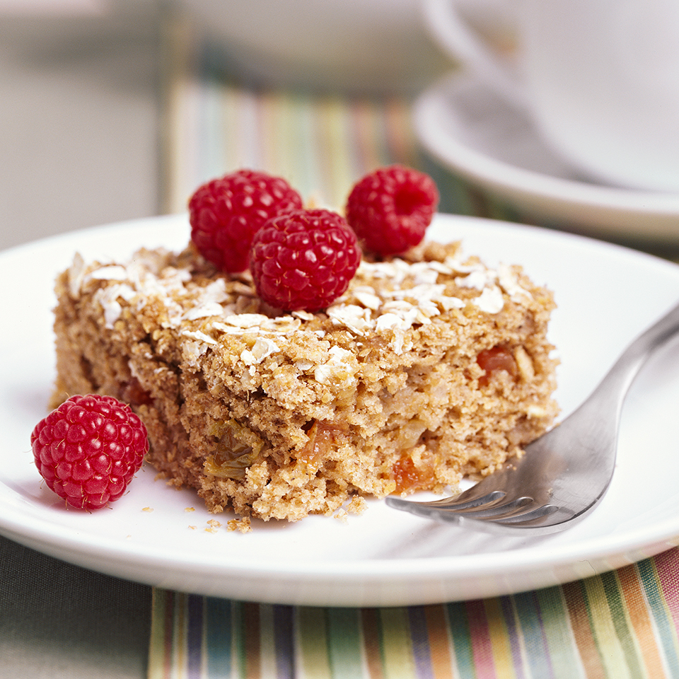 This hearty whole-grain cake is perfect for dessert or a snack. The applesauce imparts flavor and moisture while replacing some of the fat.