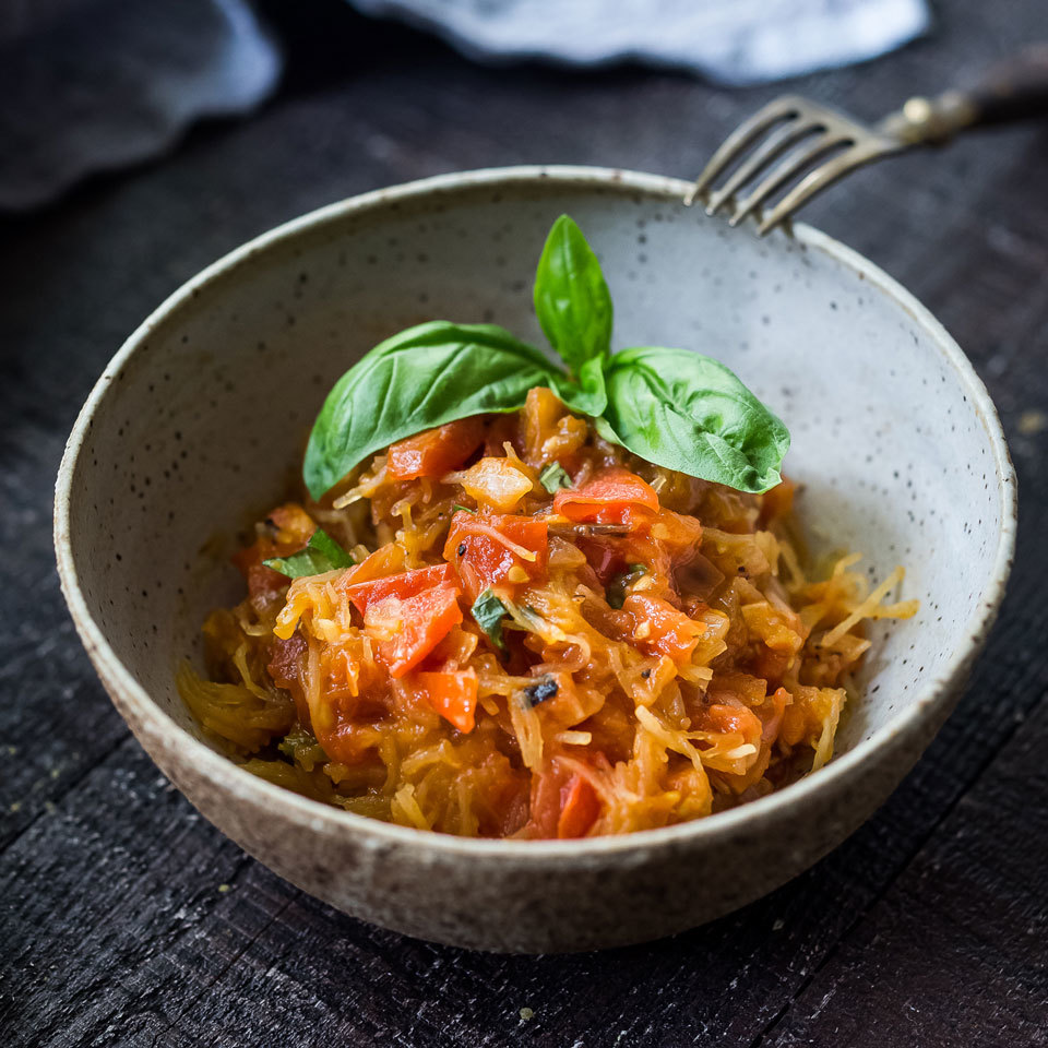 Swapping spaghetti squash for pasta is a great way to cut back on carbs and calories in this saucy vegan dinner. Here, we have tossed the squash with a simple fresh tomato sauce. Jazz up the sauce with crushed red pepper flakes, Kalamata olives and/or capers, if you like.