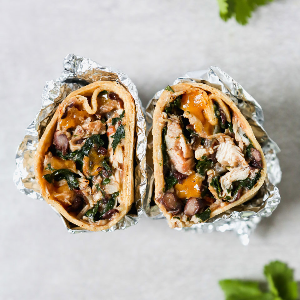 Transform leftover chicken into a hearty burrito filling! You will be thrilled to have a stash of frozen burritos on hand that you can microwave for an instant healthy lunch or on-the-go dinner for a busy night.
