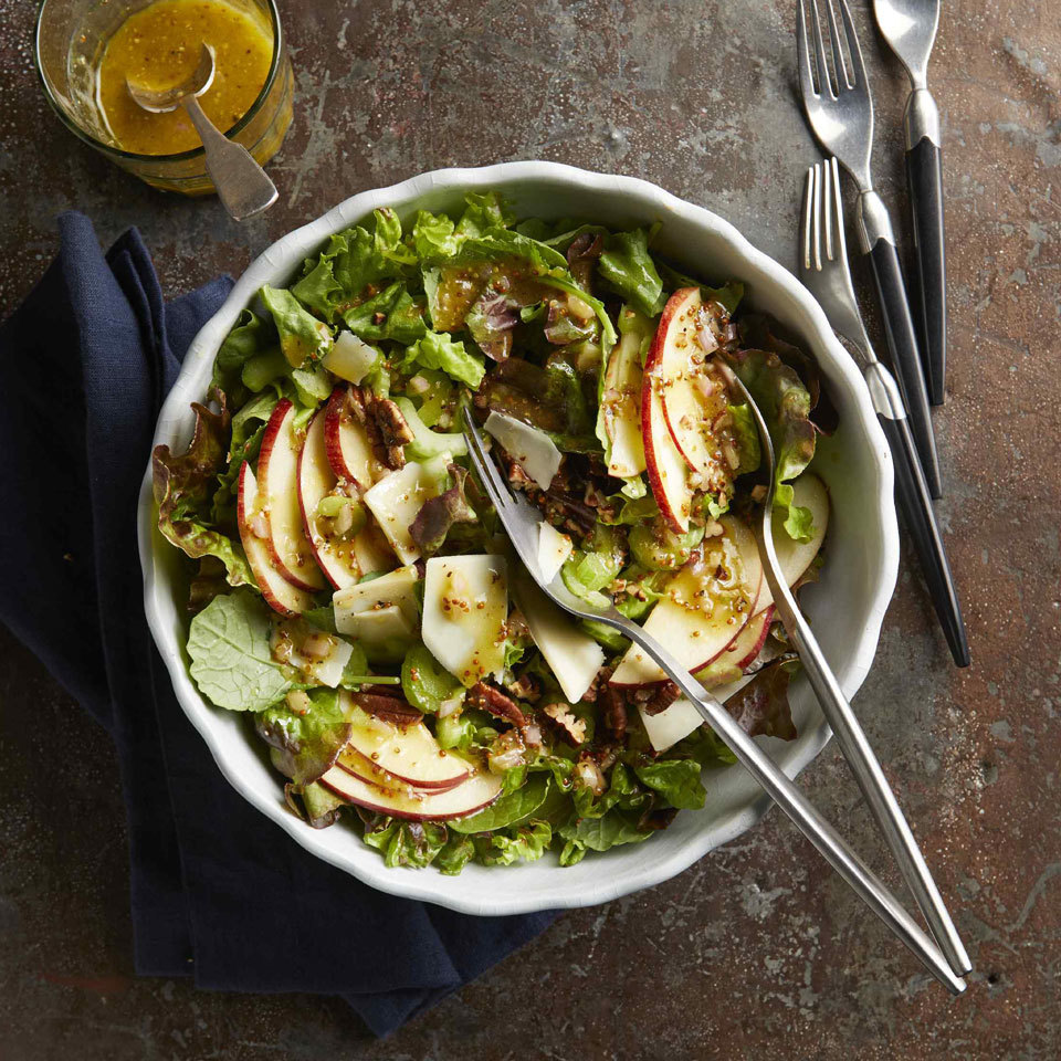 This salad is easy and festive—the perfect healthy addition to your holiday table. The no-sugar-added dressing blends well with the sweet notes of apple and sharp Cheddar cheese, and crunchy pecans round out the dish.