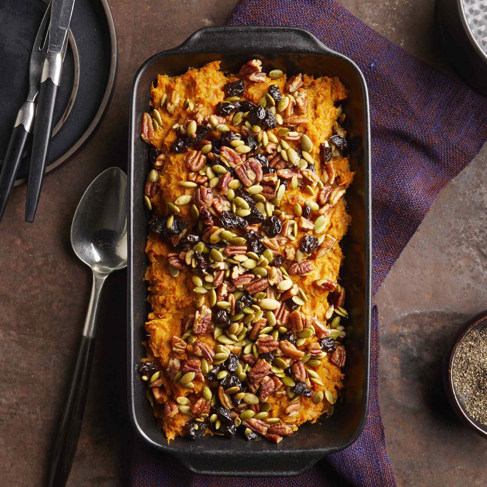 Instead of loading up this comfort food side with tons of brown sugar and marshmallows, we have turned to sweet spices, vanilla and inherently sweet dried fruit to enhance the natural sweetness of the sweet potatoes. A topping of pecans and pepitas replaces traditional marshmallow topping to keep it healthy and add texture and color for a beautiful casserole.