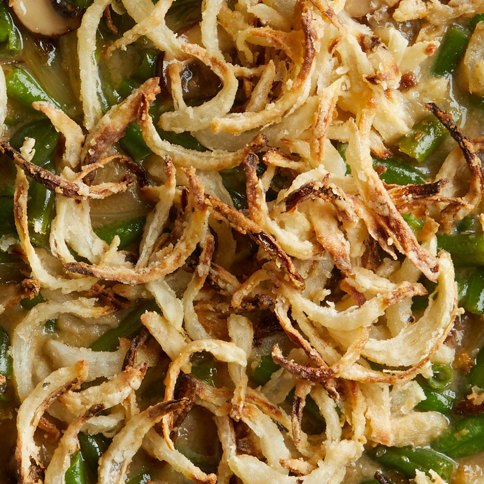 Oven-frying lightly battered onion slices produces the kind of crispy onion rings we all love, but with less fat and fewer calories. Plus, we use almond milk to make this crispy onion topping dairy-free and vegan—perfect for topping a vegan green bean casserole!