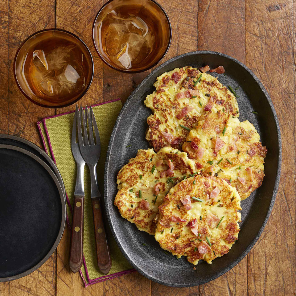 Turn your leftover mashed potatoes into delicious, savory, crispy pancakes, studded with Cheddar cheese, bacon and chives. Serve with a dollop of sour cream and some additional chives to make it extra-special.