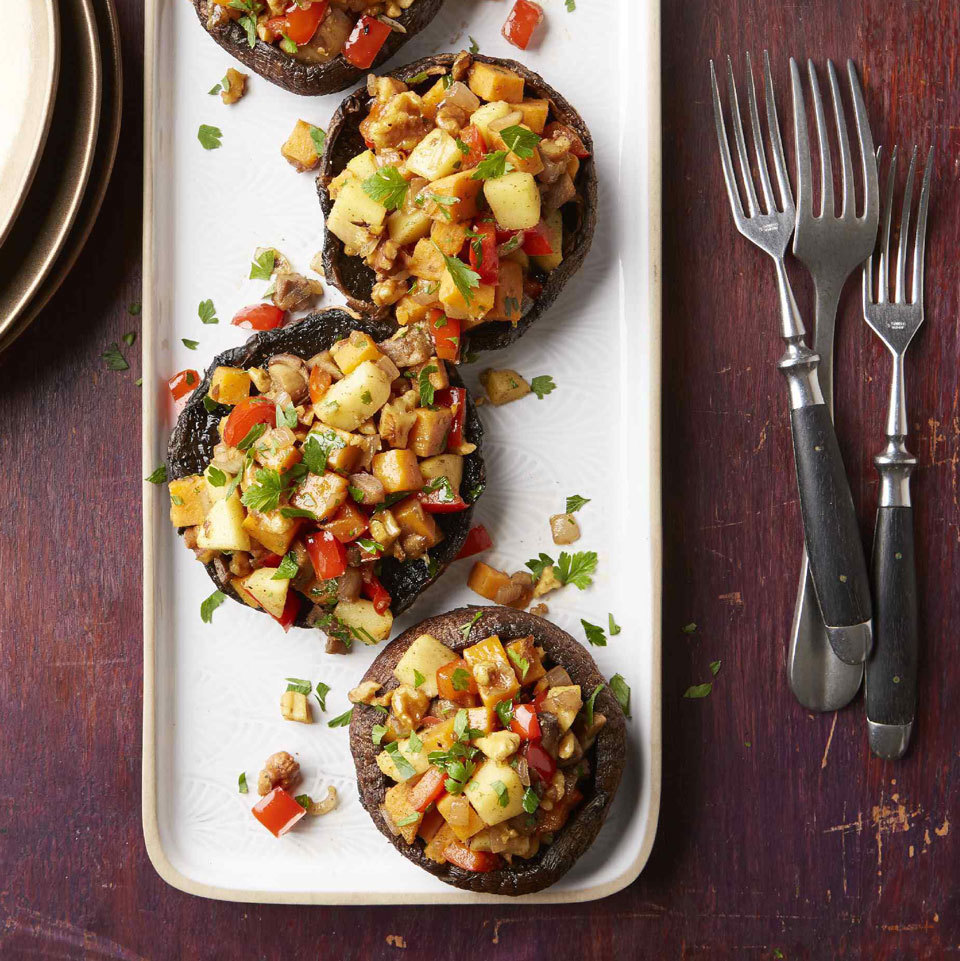 Diced sweet potato, bell peppers and apples make a vegan stuffing inspired by the flavors of sausage. To add that savory flavor, we use poultry seasoning (don't worry, there's no actual poultry in it!). Piled into portobello mushroom caps, it creates a beautiful and filling plant-based main dish—perfect for the holidays.