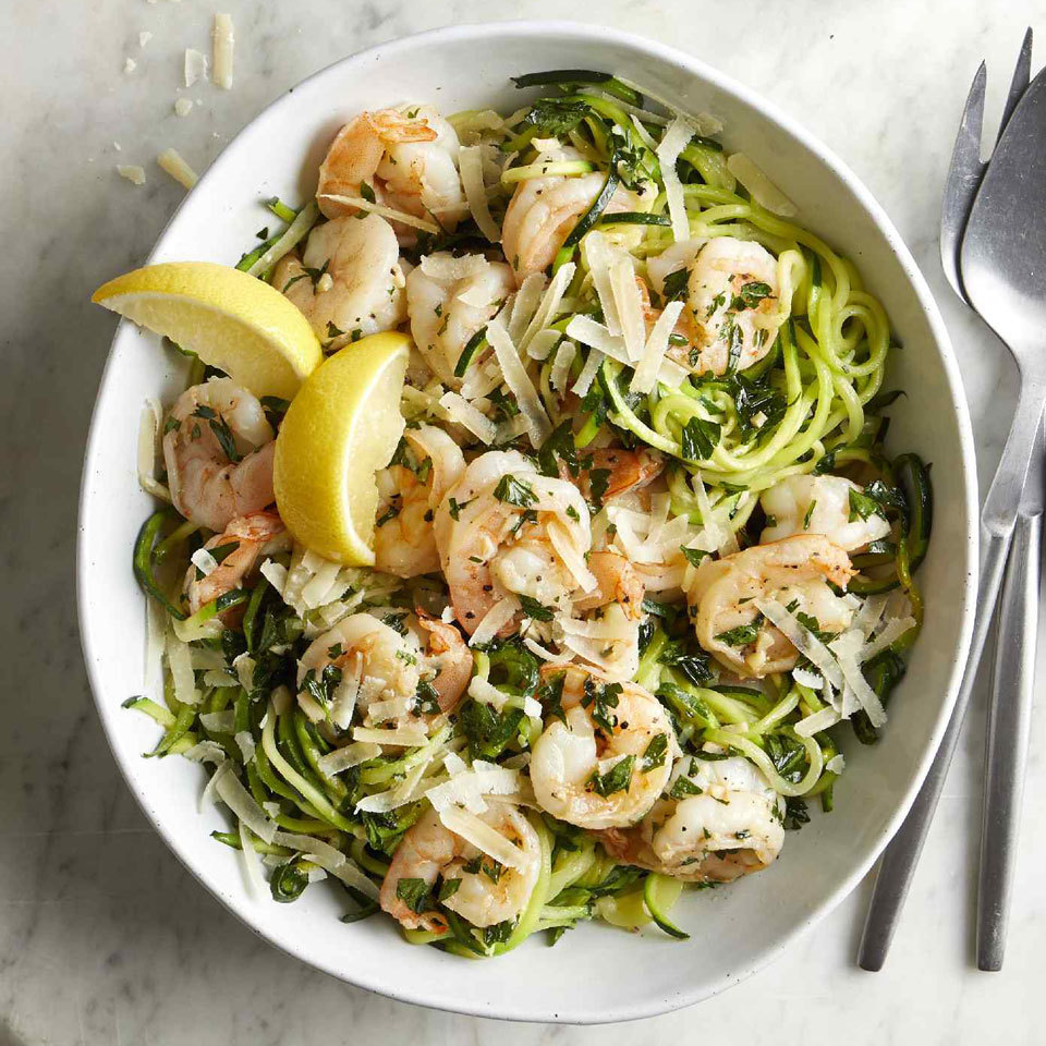 "Classic garlicky shrimp scampi gets a low-carb makeover in this easy dinner recipe. Zucchini noodles, also known as ""zoodles,"" are a healthier alternative to traditional pasta—they mimic the texture of pasta while taking on the flavor of whatever sauce you serve them with. Make sure you salt and drain the zoodles, otherwise your final dish will be soupy and the flavor will be diluted."