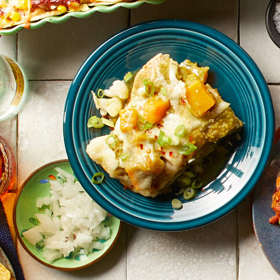 The butternut squash and cauliflower in these easy layered enchiladas are frozen and don't need to be thawed, making this a healthy and quick dinner. Look for canned tomatillos, sometimes labeled green tomatoes, in the international aisle of your grocery store.