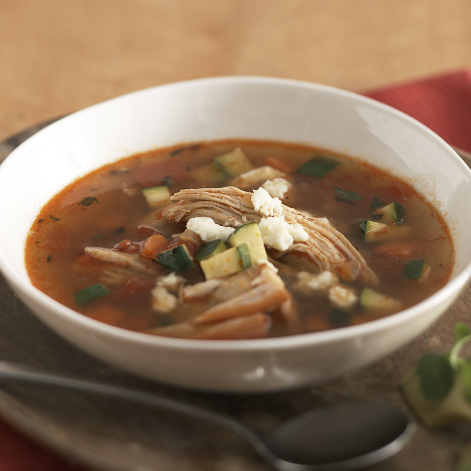 Leftover turkey is not just for sandwiches! This hearty soup recipe is full of shredded turkey and vegetables and the tasty toppings—cilantro, avocado and queso fresco—are what may just have you coming back for that second dish. Queso fresco is a mild Mexican cheese with a crumbly texture, similar to that of feta or farmer's cheese. Look for it at Hispanic food markets or larger grocery stores.