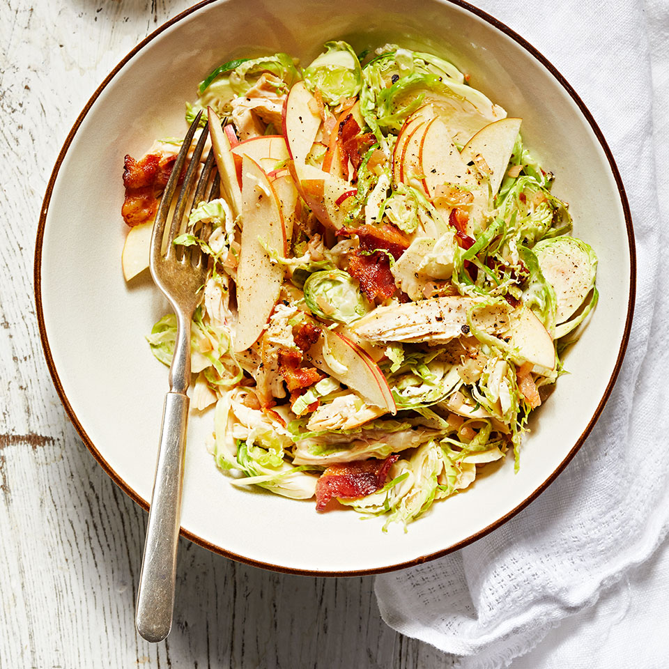 The key to this chicken salad is the homemade bacon dressing, which is made directly in the pan used to cook the bacon. Brussels sprouts are tossed with the dressing in the warm pan, allowing the residual heat to gently wilt the shredded sprouts.