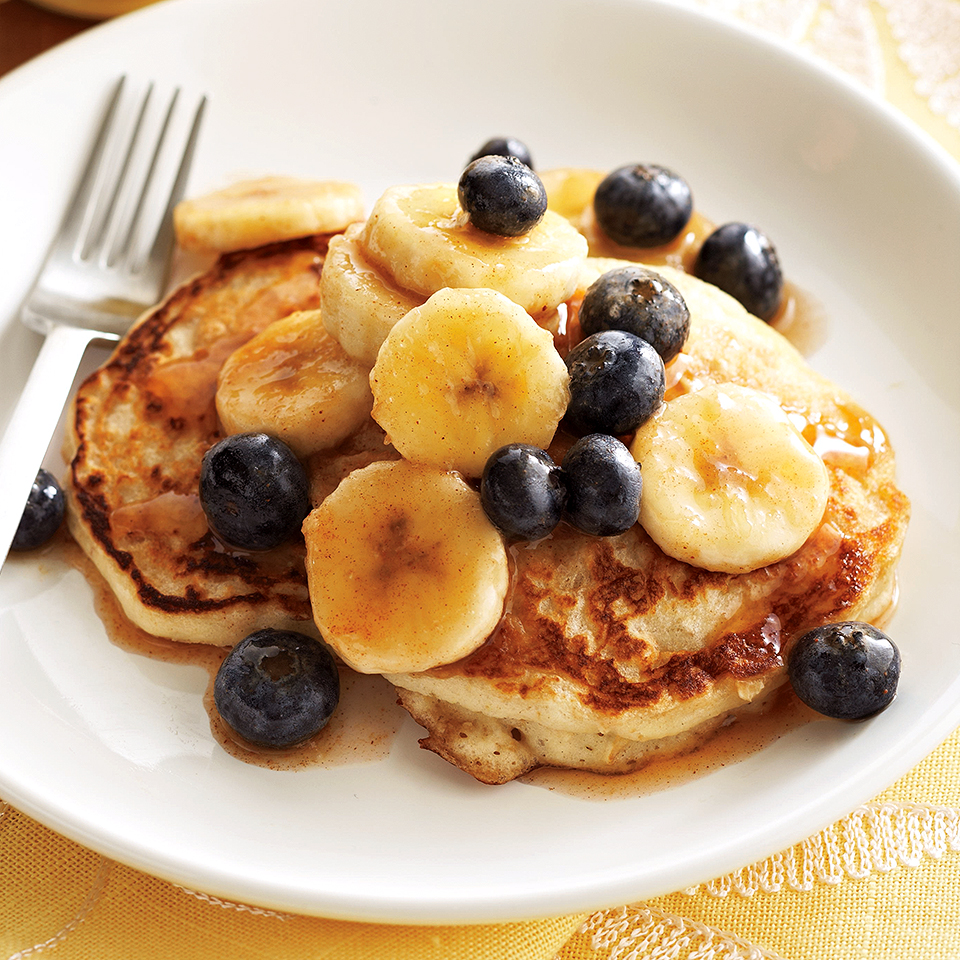 Have a full house and need a breakfast idea? Here's a quick pancake recipe that serves eight! Everyone at your table will enjoy these filling oatmeal-buttermilk pancackes, topped with fresh fruit and a decadent cinnamon-maple sauce.