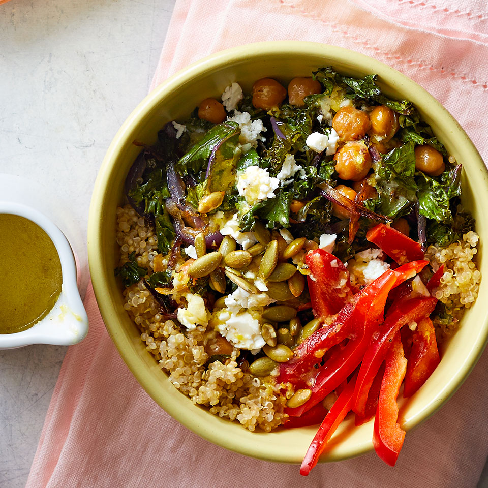 Our favorite part of these vegetarian grain bowls is the tangy lemon vinaigrette, which ties together a satisfying combo of quinoa, toasted pumpkin seeds, and roasted chickpeas and kale. Whip them up for easy meal-prep lunches or a healthy and satisfying dinner.