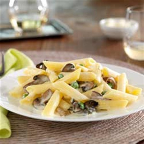 gluten free penne with mushrooms and sweet peas photos