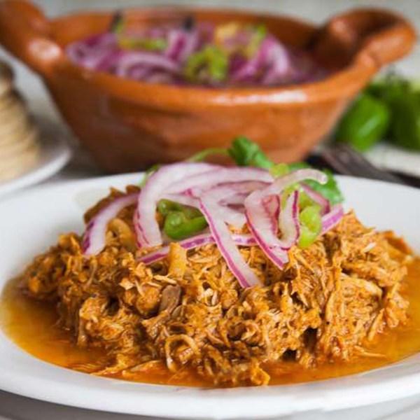 cochinita pibil mexican pulled pork in annatto sauce photos