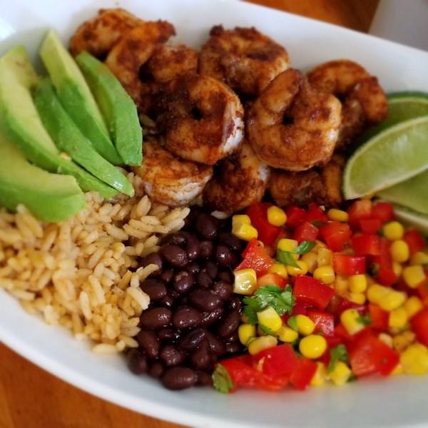 grain bowl with blackened shrimp avocado and black beans