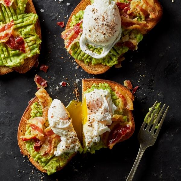 avocado toast with crumbled crispy pancetta photos