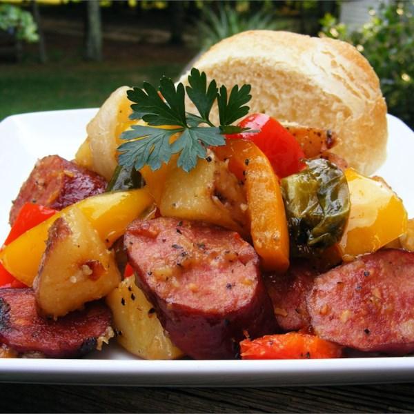 kielbasa with peppers and potatoes photos