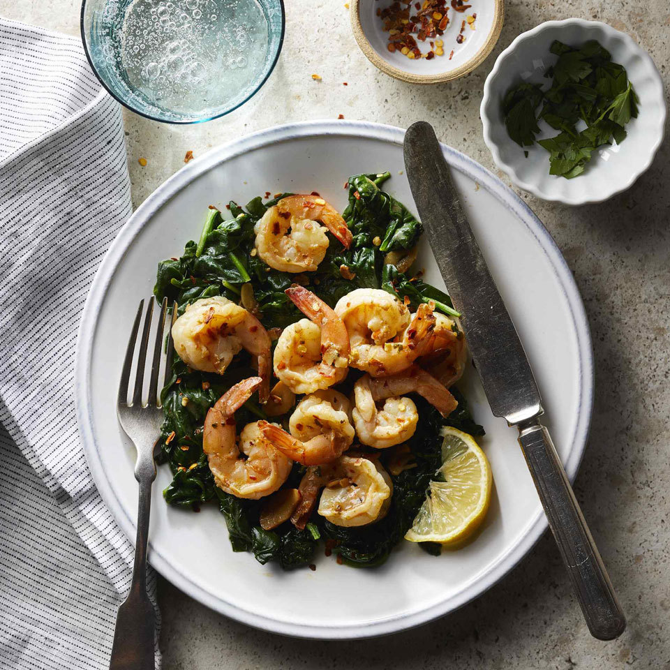 Shrimp, spinach and garlic brown and cook quickly for a simple one-pot weeknight dinner. A fast pan sauce gets life from zesty lemon juice, warm crushed red pepper and herby parsley. Serve with a slice of whole-wheat baguette to swipe up every last drop of sauce.