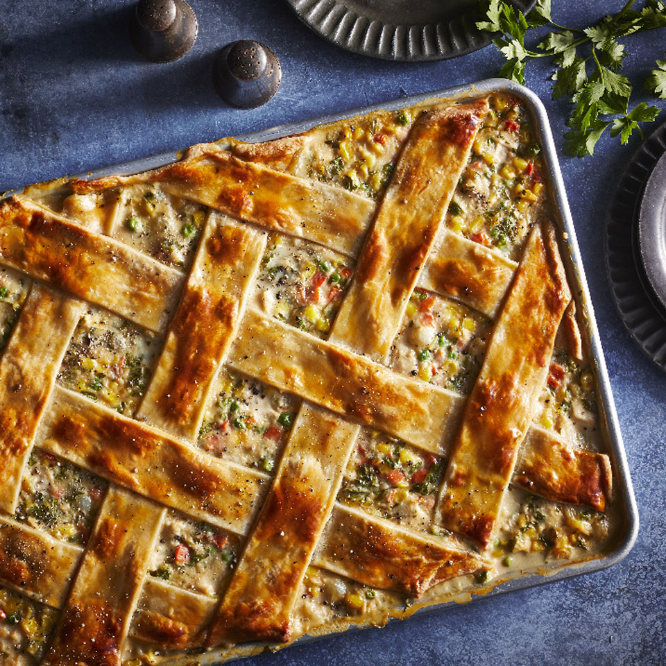 Slab fruit pies are all the rage for summer parties, so why not give classic chicken potpie the same treatment and create buzz at a cool-weather gathering as well. Premade pie crusts and frozen veggies make this chicken dinner easy to prepare without sacrificing flavor.