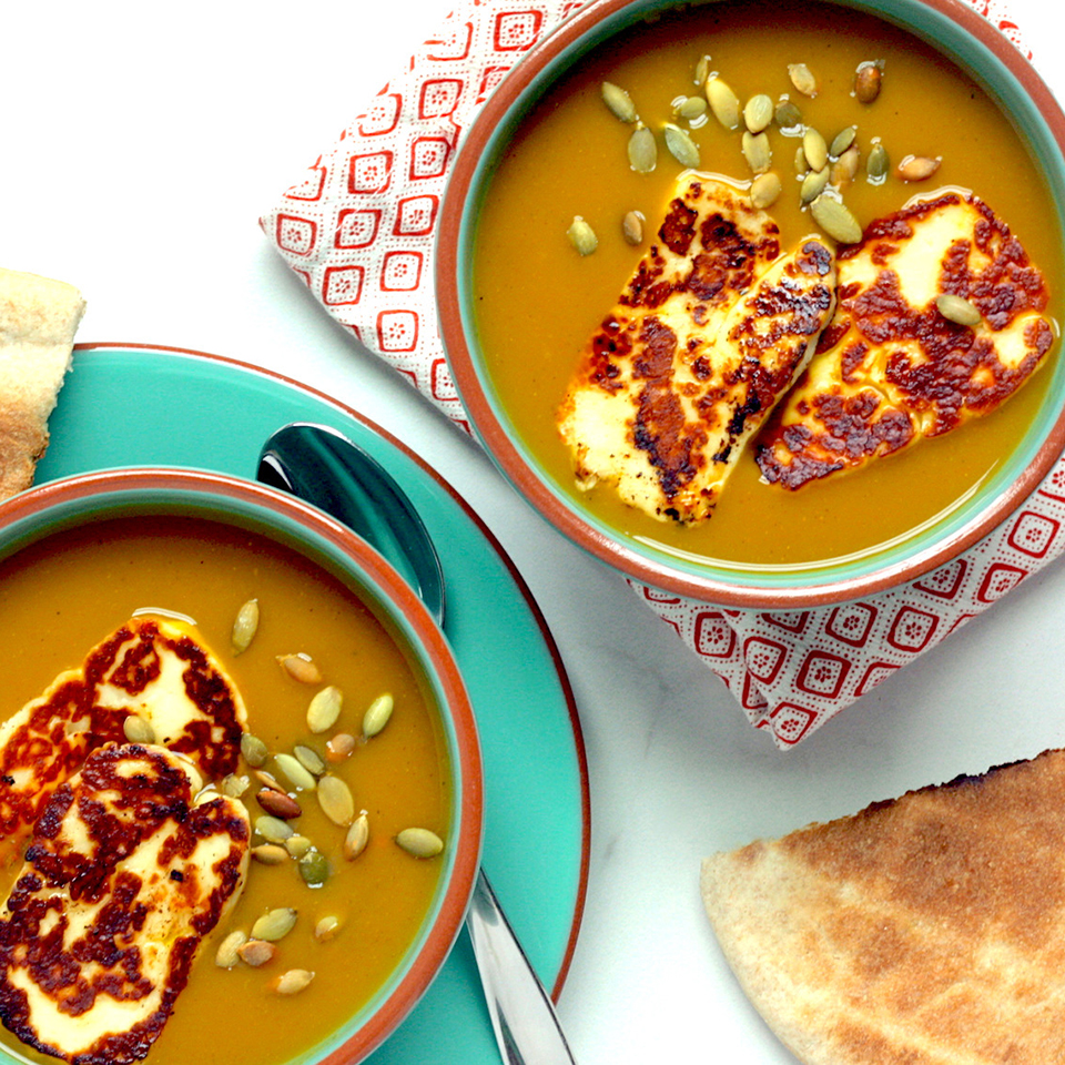 Take advantage of healthy convenience foods, such as pureed vegetable soups, to make a healthy meal in minutes. We enhance the flavor of boxed butternut squash soup with curry powder, then top it with irresistible halloumi cheese. Serve with warm whole-grain pita bread.