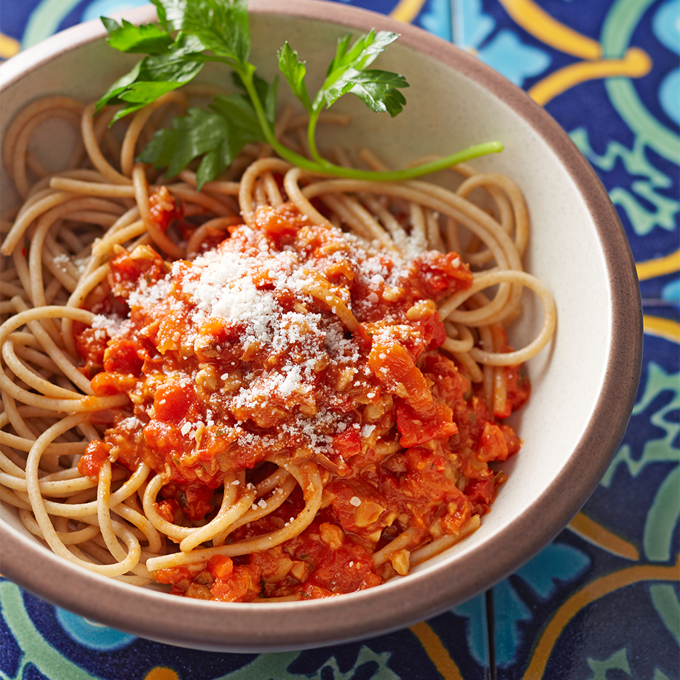 """Originating from the Catalonia region of Spain, """"salsa romesco"""" is a tomato sauce made with nuts and peppers. It's traditionally eaten with fish, but in this recipe we pair it with whole-grain pasta for a yummy vegetarian meal. Parmesan is our choice for cheese, but you can substitute Pecorino Romano or Manchego cheese if you'd like."""