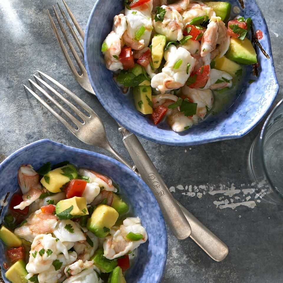 "A lime-juice marinade ""cooks"" the raw shrimp in this classic ceviche. For a refreshing update, this one is served with a salsa made from creamy avocado, juicy tomato and tangy cilantro."