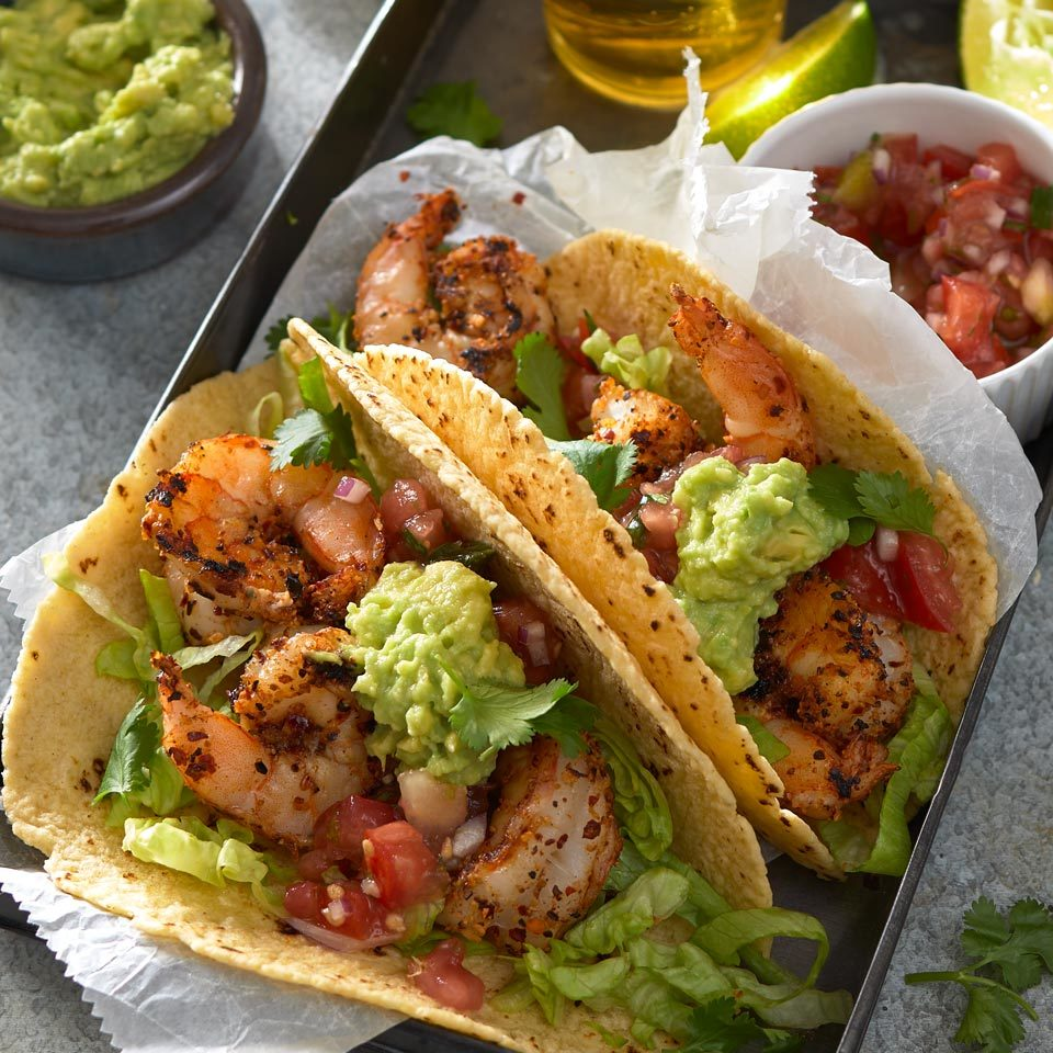 Give juicy shrimp tacos a Cajun flavor spin with spices and a quick sear on a hot grill. An easy avocado mash adds creaminess to cool off the spicy kick.